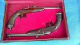 DUELING PISTOLS - CASED - 9 MM BELGIUM - PAIR - LARGE BORE - CARVED WOOD