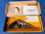 ruger sp101 in rare 32 caliber with original box and papers