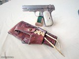 COLT 1908 - 380 CAL. - FACTORY NICKEL FINISH W/ MOTHER OF PEARL FACTORY GRIPS