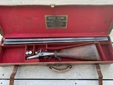 Cased 12 gauge Henry Atkin Hammer Shotgun actioned by John Robertson with original 30 inch steel barrels (relatively late hammer gun and #2 of a p
