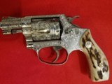 Smith & Wesson model 60 full engraved with stag grips