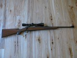 """RUGER MODEL 77 """"EXTREMELY RARE"""" FLAT BOLT .284 WIN. CALIBER W/RINGS AND FACTORY OPEN SIGHTS, 3X9 LEUPOLD"""