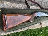 remington 870tc-an earlier trap gun with extra special wood! choke it out!