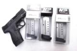 3 or more Smith & Wesson M&P Shield .40 S&W Factory 7 Shot Magazines Stainless 19934 MP40 Extension Plate $39 per on 3 or more - 1 of 10