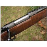 """Winchester, """"North American Game Series"""", complete set of 3 Model 70 custom rifles - 5 of 12"""