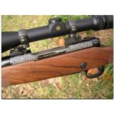 """Winchester, """"North American Game Series"""", complete set of 3 Model 70 custom rifles - 1 of 12"""