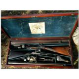Woodward and Foster, Doncaster, England. Incredibly rare 4-gun casing consisting of two sporting guns and two sporting rifles