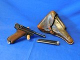 World War II Nazi Issue Masuer Code 42 Matching with 2 mags and original Cartouched Holster P08 dated 1940