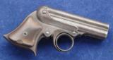 "Remington Elliot's Four Shot ""Ring Trigger"" derringer chambered in .32 rimfire and manufactured between 1883 & 1888"