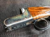 "G.E. Lewis BLE - 28 GA - 28"" Barrels - IC/Mod - Scalloped Frame - 14 1/2 X 1 3/8 X 2 1/8 - 5 lbs 10 ozs - Single Trigger - Checkered Butt - Case Color"