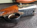 """G.E. Lewis BLE - 28 GA - 28"""" Barrels - IC/Mod - Scalloped Frame - 14 1/2 X 1 3/8 X 2 1/8 - 5 lbs 10 ozs - Single Trigger - Checkered Butt - Case Color - 16 of 22"""