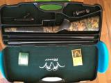 Blaser R93 with two barrels 300 win mag/375, two muzzle break, Professional stock, Swarovski Scope, and case - 11 of 14