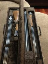 Beretta BL4 12 Guage shotgun with 3 barrels and a Browning old case