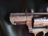 Ruger SP101, fully factory deep scroll engraved,357 magnum,2 1/4