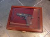 Walther PPK,75th Anniversary,LTD Edition,scroll engraved,gold accents,walnut grips,wood & glass case,all papers,1 mag,looks unfired-super nice !! - 2 of 12