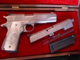 Colt Gold Cup National match 45,& Colt Ace 22lr kit,master engraved by Clint Finley,scrimshaw ivory grips,nickel,in wood case,a masterpiece