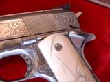 Colt Gold Cup National match 45,& Colt Ace 22lr kit,master engraved by Clint Finley,scrimshaw ivory grips,nickel,in wood case,a masterpiece - 8 of 12