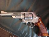 Smith & Wesson 29-3,bright polished nickel,wood grips,wood & glass pres case,6