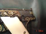 Colt Woodsman,master engraved by Jim Sorenberger with 24K Eagles & gold inlays,real Ivory grips,6