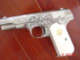 Colt 1903 hammerless,32 cal,master engraved by S.Leis,refinished nickel,1915,bonded ivory grips,awesome showpiece !!
