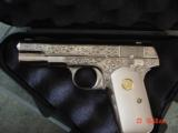 Colt 1908 380 hammerless,Master engraved by S.Leis,nickel refinished,certificate,bonded ivory grips,a work of art !! rare
