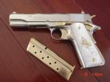 "Colt Government,38 Super,5"",fully refinished in bright nickel with 24K Gold accents,Pearlite grips,never fired,in case with manual etc.an awesome"