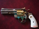"Colt Python 4"", made 1960,just refinished in bright nickel with 24K gold accents,bonded ivory grips,357 mag.,awesome like new showpiece !!"
