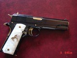 Colt Government,just refinished in bright mirror blue with 24K gold accents,45acp,5