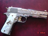 Colt Govt. 45,Master engraved by S.Leis,refinished in bright nickel with 24K accents,2 mags,Pearlite grips,certificate,case,manual,etc. awesome !!