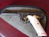 """Colt Woodsman 22LR, 1950,master engraved by Jim Sornberger,reblued with 24k gold accents,gold wire inlays & real ivory grips,rare 4"""" barrel,aweso"""