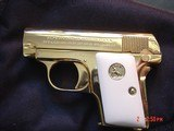 1908 Vest Pocket 25 caliber,just fully refinished in bright 24K gold,bonded ivory grips,awesome looking !!