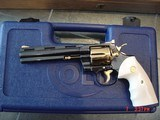 "colt python 6"" 357mag, 1974,just refinished in pres grade blue with 24k gold accents,awesome showpiece ! & rare !"