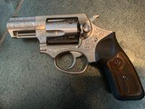 """ruger sp101, deep engraved,stainless,6 moon clips , wood & rubber grips, 2 1/4"""",357 mag , box ,papers etc."""