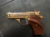 """tanfoglio italian 380 auto,model gt380 rare factory engraved, & gold plated,3 3/4"""",7 round mag with extension,wood grips with thumb rest & checke"""