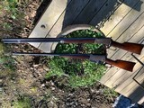 Winchester Mod 1894 rifle with octagon barrel in 32 Win Spcl, and offset scope mounts