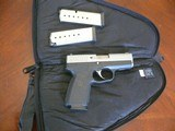 Kahr P9 9mm pistol with two extra mags