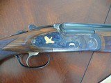 "Cortona O/U ""Prestige"" 16 ga Shotgun with engraving and gold inlays"