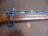 Mauser ES-340 with Redfield peep sight and nice wood!