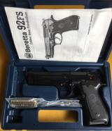 Beretta 92FS 9mm. Unfired. In the factory hard case with paper & cleaning brushes.