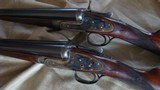 J. Purdey pair 12 ga. game guns