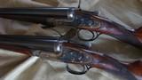 J. Purdey pair 12 ga. game guns