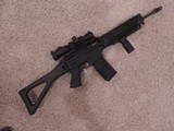 SIG SAUER MODEL SIG 556 NATO (USED IN NICE CONDITION) WITH NEW SCOPE