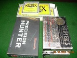 7mm remington (2 boxes herters all factorynorma mfg)(2 boxes premium ammo speer and hdy)