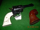 """Ruger new model .357 X 4 5/8"""" blue w/ faux ivory grips"""