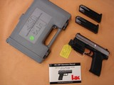 Heckler & Koch Stainless USP with tac light