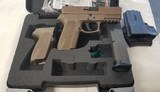 Sig Sauer SP 2022 in FDE..15 shot 9mm..with Holster, extra Mag & Grips..