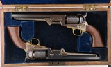 EXTREMELY RARE AND SUPERB CASED PAIR OF COLT U.S. MARTIAL MODEL 1851 NAVY REVOLVERS CIRCA 1856.