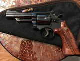 Smith and Wesson 19-3 (4 in, blue, 3 T's) - 1 of 6