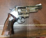 Smith and Wesson 29-2 (4 in, nickel, p and r)