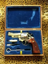 smith & wesson model 57with no dashes,,presentation case, 41 remington magnum,, 4 inch nickel, like new